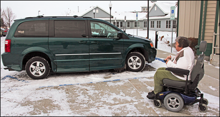 Karen Schelinder uses her power chair in 2013 to get to her van, which had a wheelchair lift.